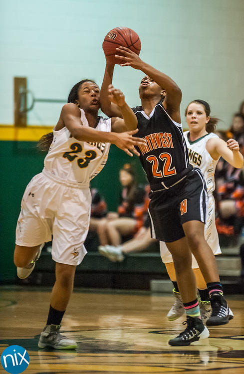 Northwest Cabarrus' Ramesha Bennett and Central Cabarrus' Elanna Peay fight for the ball Friday night at Central Cabarrus High School. Central won the game 53-48.