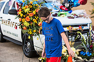 A makeshift memorial for Deputy Brad Garafola in front of the East Baton Rouge Sheriff's headquarters  covered in flowers and ballons placed on Garafola's police car in Baton Rouge on July 20, 2016. memorial.Janna Williams complained that the media covered the protests following Alton Sterling's killing more than they are the killing of the police officers.
