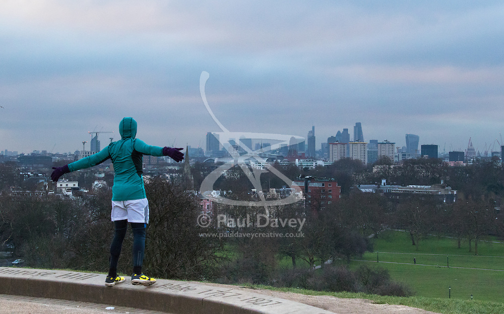 Primrose Hill, London, February 15th 2015. A man exercises on a chilly early morning on Primrose Hill, overlooking London's skyline.<br /> ///FOR LICENCING CONTACT: paul@pauldaveycreative.co.uk TEL:+44 (0) 7966 016 296 or +44 (0) 20 8969 6875. ©2015 Paul R Davey. All rights reserved.