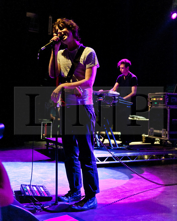 """© Licensed to London News Pictures. 02/05/2012. London, UK. The Rapture perform live at Shepherds Bush Empire.  The Rapture is an Indie rock band based in New York City. They are promoting their fourth album """"In the Grace of Your Love"""", released in 2011.  The band mixes influences from many genres including post-punk, acid house, disco, electronica and rock, pioneering the post-punk revival genre. They were forerunners of the post-punk revival of the early 2000s, as they mixed their early post-punk sound with electronic and dance elements.  Photo credit : Richard Isaac/LNP"""
