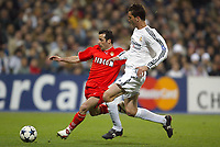 24/3/2004 Madrid, Spain.<br />Champions League. 1/4 Finals, 1 Leg.<br />R.Madrid 4 - AS Monaco 2<br />R.Madrid's  Pavon in duel against Monaco's Giuly at Santiago Bernabeu's Stadium.<br />© 2004 Alejandro leon Fernandez