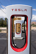 Tesla automobile drivers on Highway 395 can recharge for free while visiting the Museum of Western Film History, at 701 S. Main Street, Lone Pine, California, 93545, USA. Tesla Motors, Inc. is an American automotive and energy storage company that designs, manufactures, and sells electric cars, electric vehicle powertrain components, and battery products (NASDAQ stock symbol TSLA). It first posted profits in 2013. The Tesla Roadster was the world's first fully electric sports car; and the Model S is a fully electric luxury sedan. As of 2015, CEO Elon Musk envisions Tesla Motors as an independent automaker aimed at eventually offering electric cars at prices affordable to the average consumer.