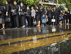 October 14, 2016 - Bangkok, Bangkok, Thailand - People stand in line to enter the Grand Palace in Bangkok to pay respects to Bhumibol Adulyadej, the King of Thailand, who died Oct. 13, 2016. He was 88. His death comes after a period of failing health. With the king's death, the world's longest-reigning monarch is Queen Elizabeth II, who ascended to the British throne in 1952. Bhumibol Adulyadej, was born in Cambridge, MA, on 5 December 1927. He was the ninth monarch of Thailand from the Chakri Dynasty and is known as Rama IX. He became King on June 9, 1946 and served as King of Thailand for 70 years, 126 days. He was, at the time of his death, the world's longest-serving head of state and the longest-reigning monarch in Thai history. (Credit Image: © Jack Kurtz via ZUMA Wire)
