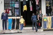 A women walks into a business in Banos, Ecuador.