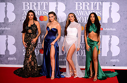 Jesy Nelson, Perrie Edwards, Jade Thirlwall and Leigh-Anne Pinnock (left-right) of Little Mix attending the Brit Awards 2019 at the O2 Arena, London.