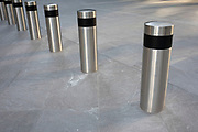 Bollards as a security precaution in the City of London on 28th January 2020 in London, England, United Kingdom. The City of London is a historic financial district, home to both the great banking buildings. Modern corporate skyscrapers tower above the vestiges of medieval alleyways below.