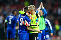 Kasper Schmeichel of Leicester City thanks goalscorer Jamie Vardy after a 2-1 loss - Rogan Thomson/JMP - 22/02/2017 - FOOTBALL - Estadio Ramon Sanchez Pizjuan - Seville, Spain - Sevilla FC v Leicester City - UEFA Champions League Round of 16, 1st Leg.