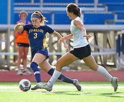 OFallon forward Aubrey Mister (left) moves the ball past Edwardsville midfielder Olivia Baca. OFallon defeated Edwardsville in a girls soccer playoff game at OFallon High School in OFallon, IL on Tuesday June 8, 2021. <br /> Tim Vizer/Special to STLhighschoolsports.com.