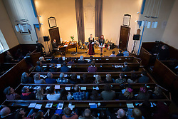 © licensed to London News Pictures. London, UK 03/11/2013. Fans singing in memory of Lou Reed at a memorial service at Newington Green Unitarian Chapel in London to commemorate the musician who died on October 27, 2013. Photo credit: Tolga Akmen/LNP