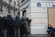 December, 8th, 2018 - Paris, Ile-de-France, France: Riot police near Montblanc shop Champs Elysees. The French 'Gilets Jaunes' demonstrate a fourth day. Their movement was born against French President Macron's high fuel increases. They have been joined en mass by students and trade unionists unhappy with Macron's policies. Nigel Dickinson