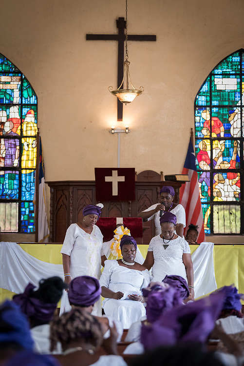 1 November 2019, Careysburg, Liberia: Members of the National Women's Missionary Union of the Liberia Baptist Missionary and Educational Convention gather in prayer for Deacon Moriah G. Wisseh, National director of the Baptist Women of Liberia, as they observe the annual Baptist Women's World Day of Prayer in the Mount Galilee Baptist Church on Mount Vomblee in Careysburg, Montserrado County, Liberia. The Liberia Baptist Missionary and Educational Convention is a full member of the Liberia Council of Churches, and holds the second vice position there. The Day of Prayer is observed each year in November, at which time offerings are collected and shared with the Baptist World Alliance as a contribution to mission work around the world.