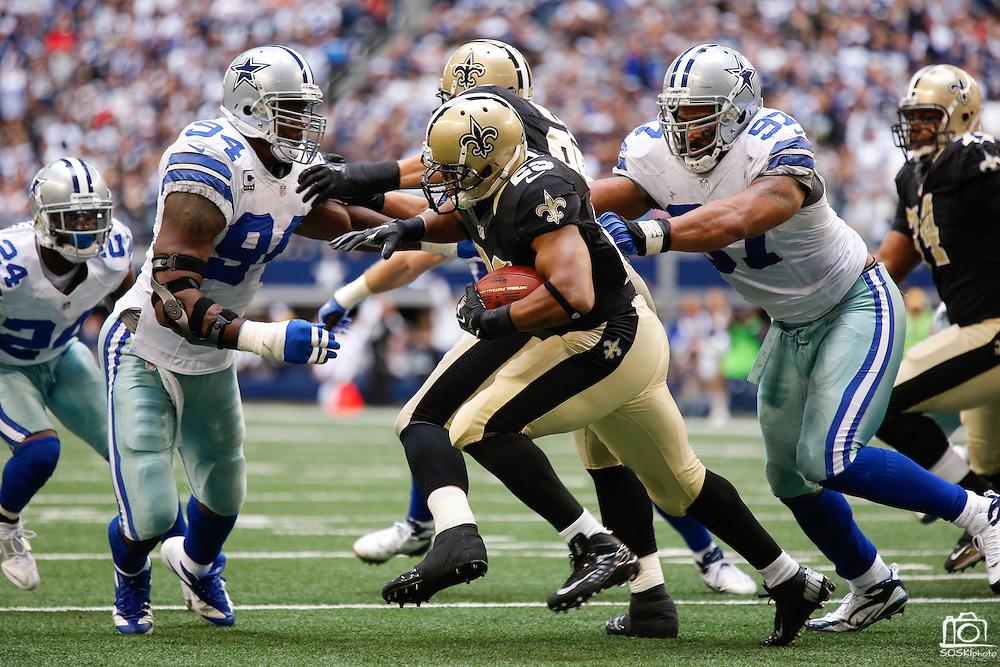 New Orleans Saints running back Pierre Thomas (23) carries the ball against the Dallas Cowboys defense at Cowboys Stadium in Arlington, Texas, on December 23, 2012.  (Stan Olszewski/The Dallas Morning News)
