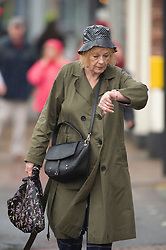 ©Licensed to London News Pictures 09/09/2019.<br /> Chislehurst ,UK. Time for rain. People out and about in the wet weather in Chislehurst High Street, Chislehurst, South East London.The Met office has issued a yellow weather warning as thunderstorms are expected across parts of the UK. Photo credit: Grant Falvey/LNP