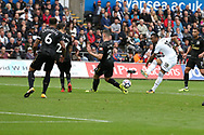 Jordan Ayew of Swansea city (18) has a shot at goal. Premier league match, Swansea city v Newcastle Utd at the Liberty Stadium in Swansea, South Wales on Sunday 10th September 2017.<br /> pic by  Andrew Orchard, Andrew Orchard sports photography.