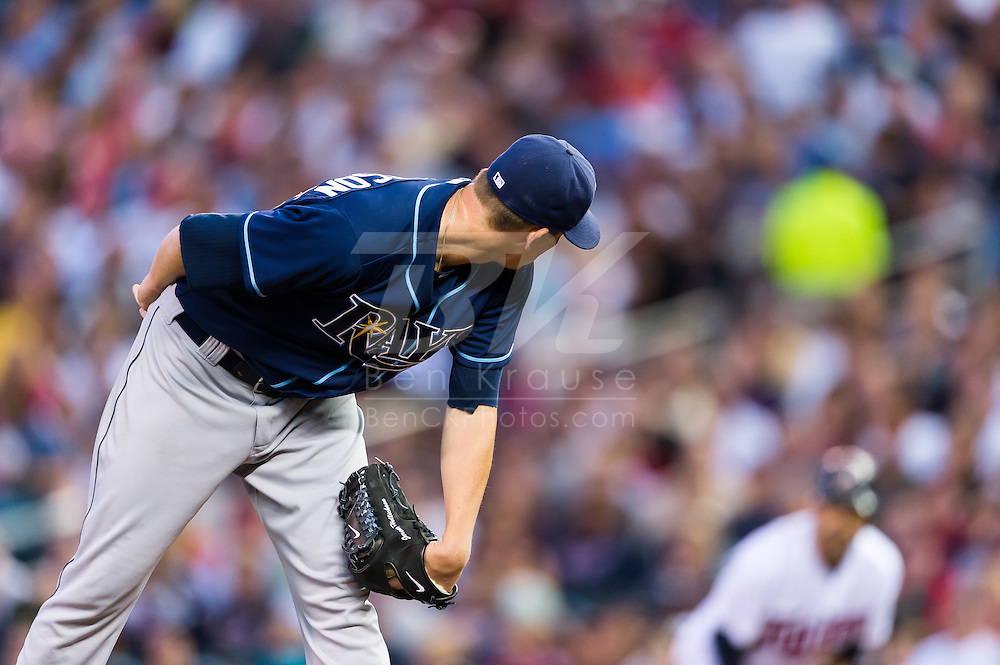 Jeremy Hellickson (58) of the Tampa Bay Rays checks the runner at 1st base during a game against the Minnesota Twins on August 10, 2012 at Target Field in Minneapolis, Minnesota.  The Rays defeated the Twins 12 to 6.  Photo: Ben Krause