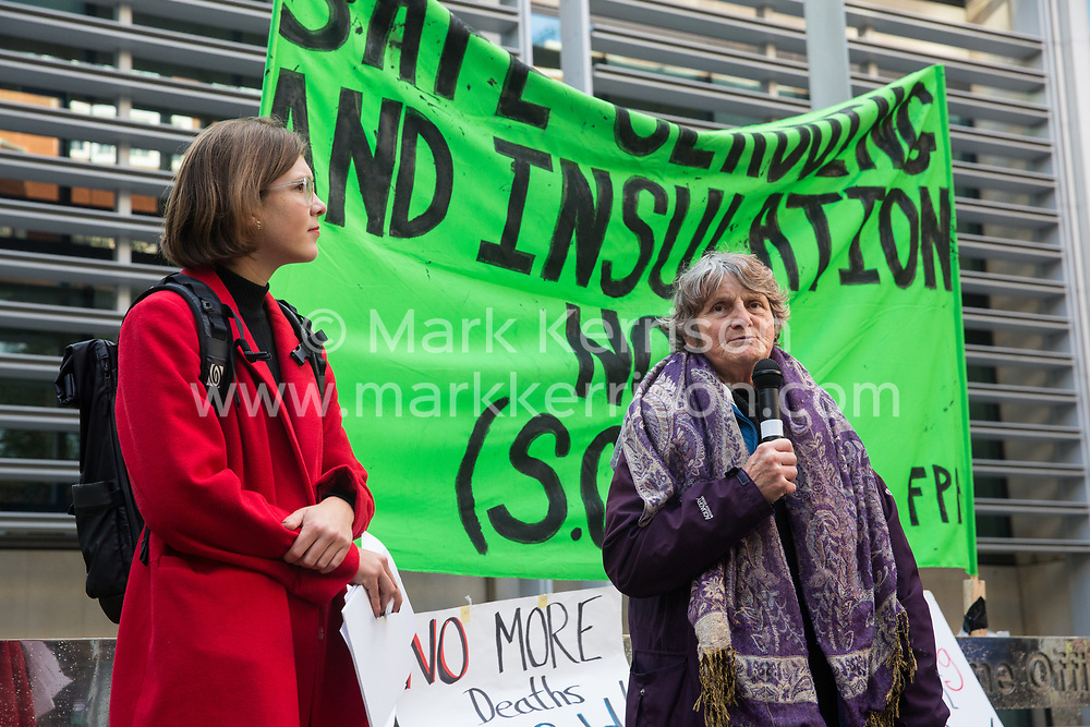 London, UK. 17 October, 2019. Sandra, a Peabody resident from Hackney, addresses campaigners from Fuel Poverty Action (FPA), residents in uninsulated homes and climate activists protesting outside the Ministry of Housing, Communities and Local Government (MHCLG) before delivering a letter signed by FPA, 80 organisations, trade unions and MPs in just ten days precisely one year after a strongly worded letter about the urgency of recladding flammable buildings and insulating those that are cold was delivered to the Government department. Commitments made by the MHCLG in response to the original letter have not been met. Credit: Mark Kerrison/Alamy Live News