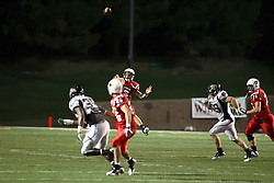 25 September 2010:  Matt Brown passes the direction of Corey Shandrick and defender Terian Washington.  The Missouri State Bears lost to the Illinois State Redbirds 44-41 in double overtime, meeting at Hancock Stadium on the campus of Illinois State University in Normal Illinois.