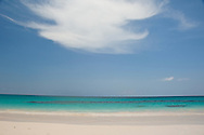 An unusual cloud formation above emerald seas at Pink Sands Beach, Harbour Island, The Bahamas