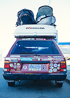 Car with surfboards.