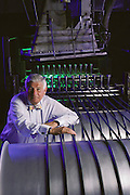 Physics: Raychem Corporation's CEO Paul Cook in electron accelerator radiation chamber (plastic pipe irradiation) MODEL RELEASED [1987]