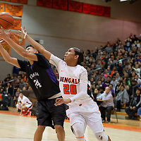 Miyamura Patriots small forward Darin Baca (24) wins the defensive rebound from a reaching Gallup Bengals Quincy Smith (20) during the 4A -District Tournament Championship game at Gallup High School Saturday.