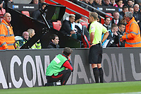 Football - 2019 / 2020 Premier League - Southampton vs. Newcastle United<br /> <br /> Referee Mr Graham Scott checks the pitch side VAR screen for a possible red card during the Premier League match at St Mary's Stadium Southampton <br /> <br /> COLORSPORT/SHAUN BOGGUST