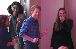 Prince Harry dances before watching a rehearsal of the Joyful Noise choir, a group from NAZ, a sexual health charity for minority communities, at The Hurlingham club in London.