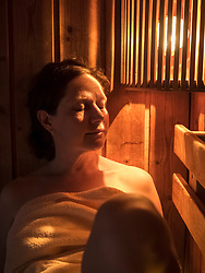 Woman relaxing in sauna of Paracelsus-Therme, Bad Liebenzell, Baden-Württemberg, Germany