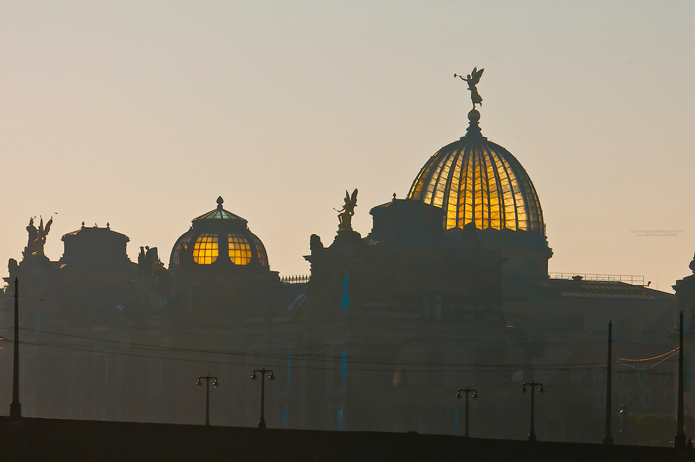 """The Elbe River with a statue of an angel holding the """"Trumpet of Fame"""" atop the glass dome known as the Lemon Squeezer (Zitronenpresse) on the Kunstakademie (Art Academy) in background, Dresden, Saxony, Germany"""