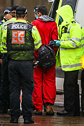 """Leicester, United Kingdom, May 21, 2021: Police arrested two (one of them in picture) of the activists from the """"Palestine Action"""" activists group who occupied the building of the Israeli-owned Elbit-Thale subsidiary UAV Tactical Systems for three consecutive days in the city of Leicester United Kingdom on Friday, May 21, 2021. Three days ago activists sprayed red paint on the building and demand that it shuts down. The company's operations are at a halt for three consecutive days now with police negotiating a truce between activists and the company. Activists argue that the drones being manufactured in the facility are being used in indiscriminate attacks against the Gaza Strip. Two activists remain to occupy the building. (Photo by Vudi Xhymshiti)"""