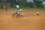 Boy catching up with his relatives, Rwanda