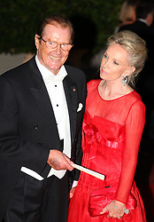 File photo dated 02/07/11 of Sir Roger Moore and wife Kristina. Sir Roger has died in Switzerland after a short battle with cancer, his family has announced.
