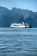 Coron, Philippines - July 20, 2019: The St. Francis Xavier, a passenger ferry belonging to the 2GO passenger ferry company based in Manila, sails out of Coron Town bound for Puerto Princesa on Palawan.