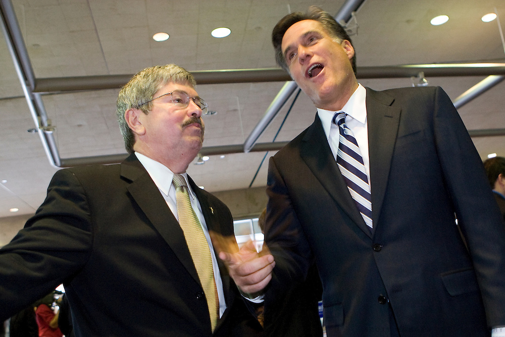 Former Republican presidential hopeful and Gov. Mitt Romney, R-MA, talks to former Iowa Gov. Terry Branstad Saturday, April 14, 2007 during the Lincoln Unity Dinner at the Polk County Convention Complex in Des Moines, Iowa. Copyright Scott Morgan 2007