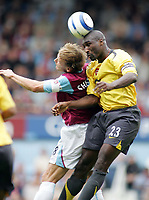 Photo: Paul Thomas.<br /> West Ham United v Arsenal. The Barclays Premiership. 24/09/2005.<br /> <br /> Arsenal captain Sol Campbell beats Teddy Sheringham to the ball.