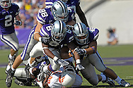 Kansas State defenders Ian Campbell (98), Brandon Archer (46) and Byron Garvin (6) gang tackle Oklahoma State running back Mike Hamilton (29) in the first half at Bill Snyder Family Stadium in Manhattan, Kansas, October 7, 2006.  The Wildcats beat the Cowboys 31-27.