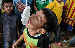 August 16, 2017 - Lhokseumawe, Aceh, Indonesia - A child participated in a snack competition during the 72th Indonesia Independence Day celebration, in Lhokseumawe on 17 August 2017, in Aceh Province, Indonesia. People participate in traditional games every year to celebrate Indonesia's Independence Day commemorated every August 17th. (Credit Image: © Fachrul Reza/NurPhoto via ZUMA Press)