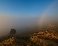 Fog Rainbow over the Little Missouri river valley. Image taken with a Nikon D3x camera and 14-28 mm f/2.8 lens (ISO 100, 14 mm, f/16, 1/40 sec).