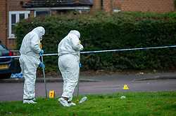 © Licensed to London News Pictures. 09/01/2020. Didcot, UK. Police forensic investigators search for evidence in the Mendip Heights estate where three men were injured during an incident and were taken to hospital for treatment. One of the men, aged in his forties was later pronounced dead and a murder investigation was launched. The victim received multiple stab wounds. Two other victims, one man in his twenties and another man in his thirties, are in serious but stable conditions in hospital. Photo credit: Peter Manning/LNP