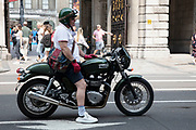 Man on a vintage Triumph motorcycle in London, United Kingdom. Triumph Motorcycles Ltd is the largest British motor bike manufacturer, established in 1983. by John Bloor after the original company Triumph Engineering went into receivership. The new company, initially called Bonneville Coventry Ltd. continued Triumphs record of motorcycle production since 1902.