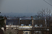 London, UK. Wednesday 2nd April 2014. Industrial pollution from Europe and dust from the Sahara region creates a layer of smog over the City of London. Barely visible through the poplluted air, the buildings seem to disappear into the poor air quality. Here the city is virtually invisible from Crystal Palace.