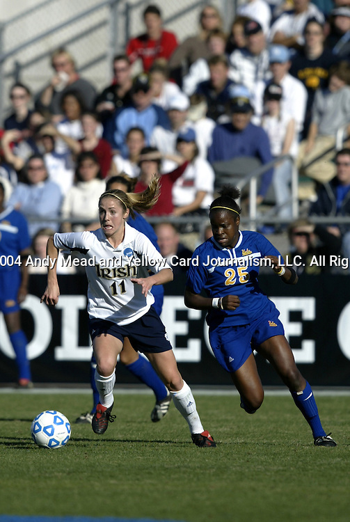 05 December 2004: Annie Schefter (11) and Danesha Adams (25). Notre Dame defeated UCLA 4-3 on penalty kicks after the game ended in a 1-1 overtime tie at SAS Stadium in Cary, NC in the championship match in the 2004 NCAA Division I Women's College Cup..