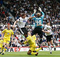 Photo: Steve Bond.<br />Derby County v Leeds United. Coca Cola Championship. 06/05/2007.Leeds keeper Caspar Ankargren fails to gather under pressure from Steve Howard (L) & Paul Peschisolido (R)