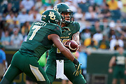 WACO, TX - SEPTEMBER 2:  Anu Solomon #12 of the Baylor Bears hands the ball off to John Lovett #7 against the Liberty Flames during a football game at McLane Stadium on September 2, 2017 in Waco, Texas.  (Photo by Cooper Neill/Getty Images) *** Local Caption *** Anu Solomon; John Lovett