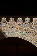 Detail of an old engraving on an arched doorway in the medina of Fes, Morocco