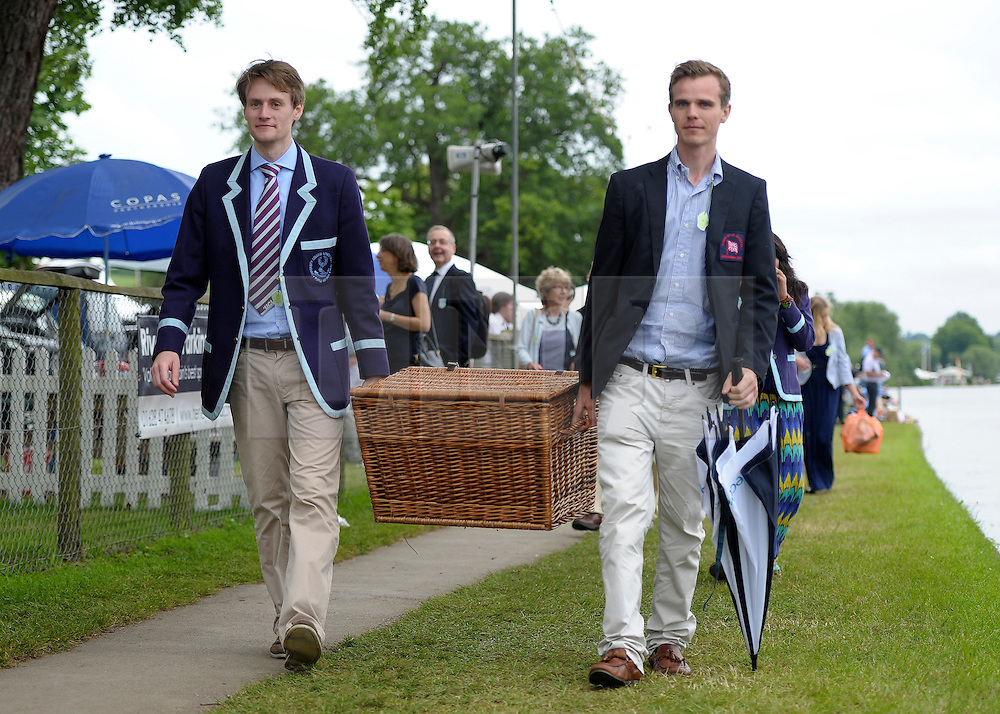 © Licensed to London News Pictures. 27/06/2012. Henley-on-Thames, UK Two men carry picnic basket. Spectators watch rowing crews compete at the Henley Royal Regatta on June 26, 2012 in Henley-on-Thames, England. The 172-year-old rowing regatta is held 27th June- 1st July 2012. Photo credit : Stephen Simpson/LNP