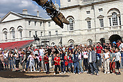 The gigantic mechanical elephant spraying water on the crowd from his arena in central London, on Friday, May 5, 2006. The Sultan's Elephant show, for the first time in London is a magical, and unique in the world, theatrical show across the streets, performed by an international French company - Royal De Luxe - specialised in constructing and giving 'life' to enormous mechanical puppets. The Sultan's Elephant is the story of a Sultan dreaming of a little girl that travels through time. **ITALY OUT**
