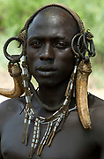Young Man wearing head gear, Mursi Tribe, Mago National Park, Lower Omo Valley, Ethiopia, portrait, person, one, tribes, tribal, indigenous, peoples, Southern, ethnic, rural, local, traditional, culture, primitive,
