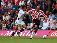 Photo: Alan Crowhurst.<br /> Southampton v Anderlecht, Pre Season Friendly, 30/07/2005. Saints Danny Higginbotham tries to escape the Anderlecht defence.