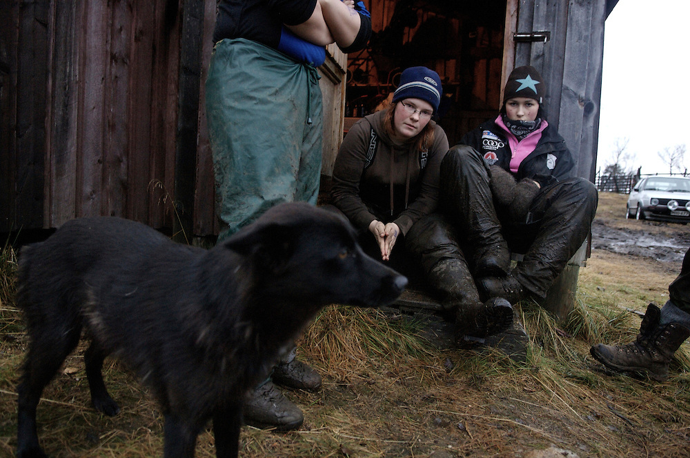 Hirvas Salmi, FINLAND.  Annirauna Triumf, 16, (far right) gazes at her friend after working an 11 hour day.  She lives in Norway with her mother but comes to Finland for this ?reindeer school? five times a year.  This is a way that youth straddle both the modern day lives while retaining age-old traditions...